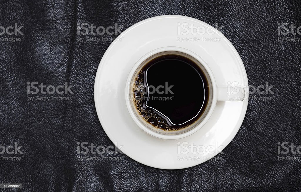 espresso coffee in white cup directly above, black leather back royalty-free stock photo