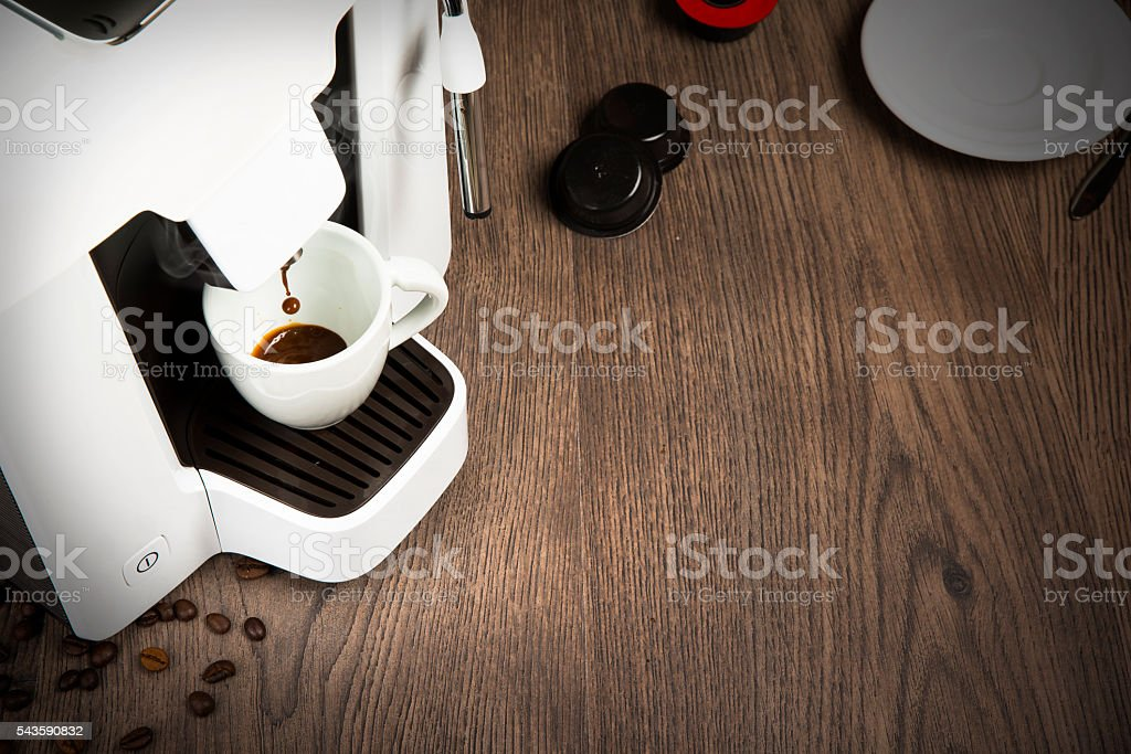 espresso coffee made with capsules at home stock photo