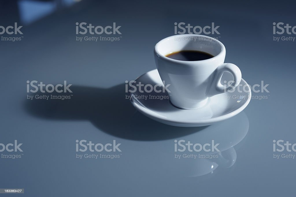 Espresso Coffee on Glass Table Top royalty-free stock photo