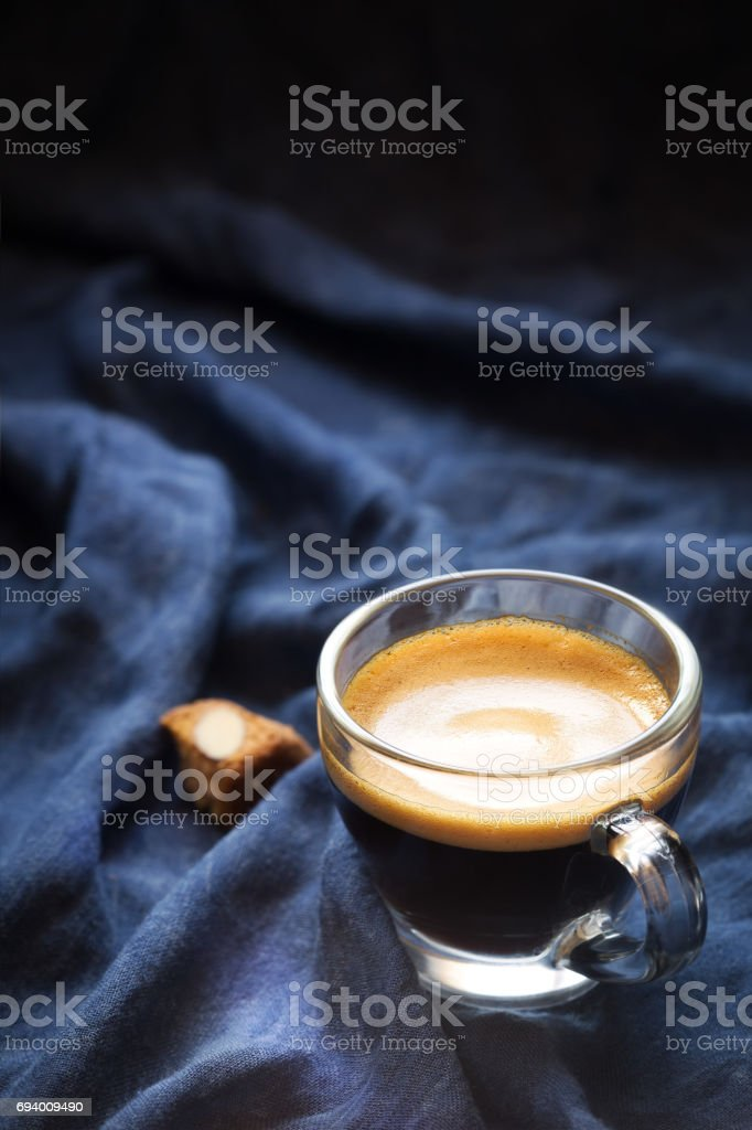 Espresso coffee with a chunk of almond cantucci biscuit stock photo