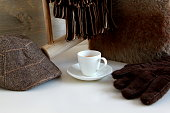 Espresso Coffee with hat, gloves and scarf on white table