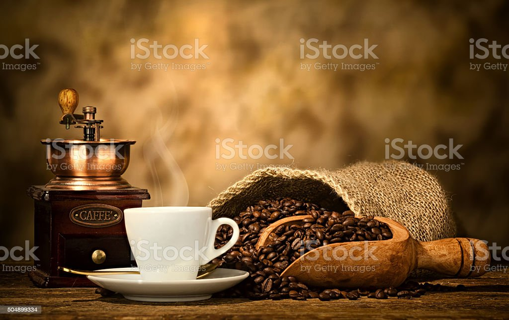 Espresso coffee with old coffee grinder stock photo