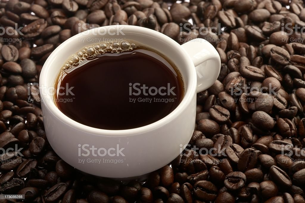 Espresso cup and beans royalty-free stock photo