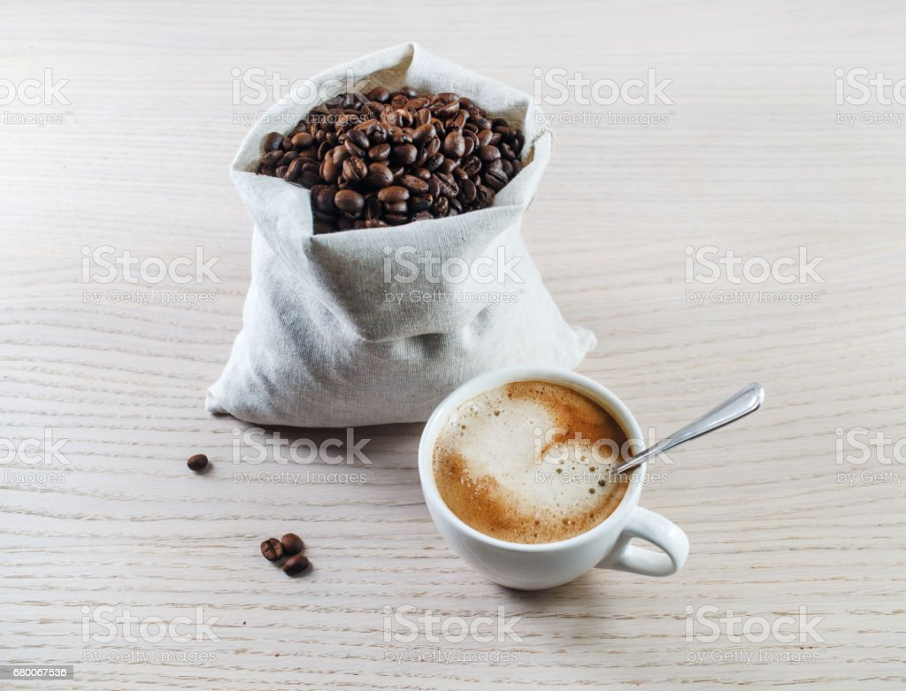 Espresso cup and coffee beans stock photo