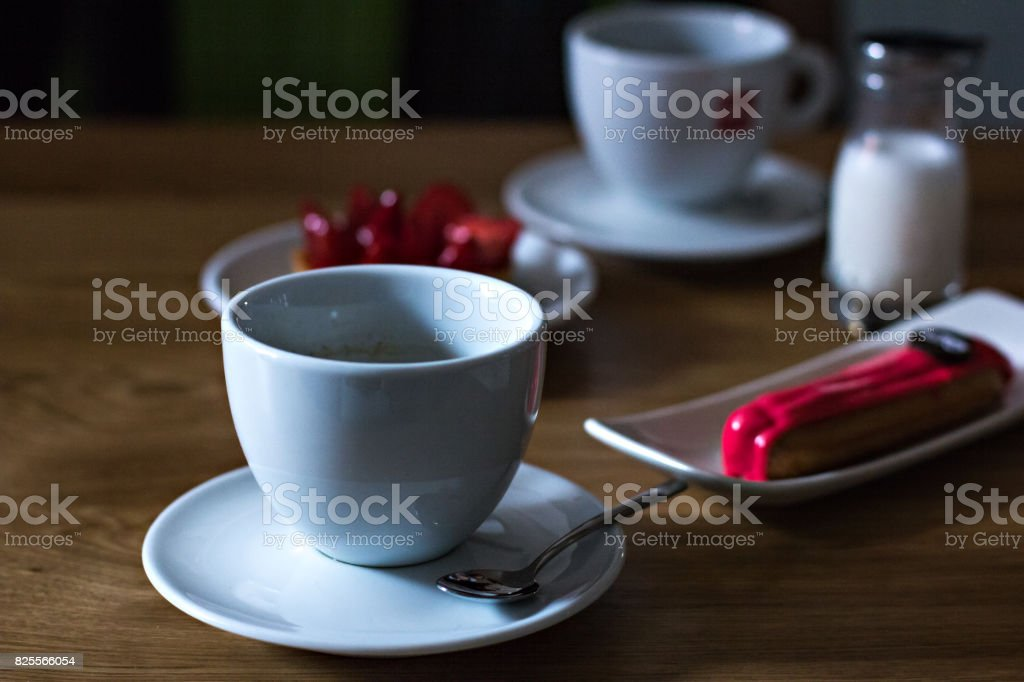 Espresso Cup and Eclair Cupcake stock photo