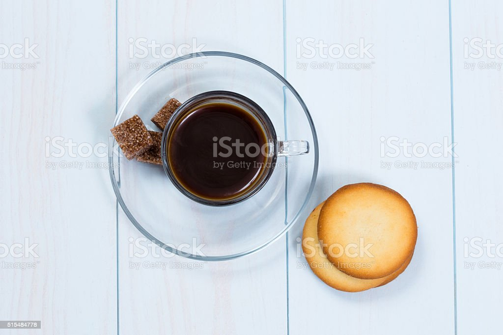 Espresso cup of black coffee with sugar and cookies stock photo