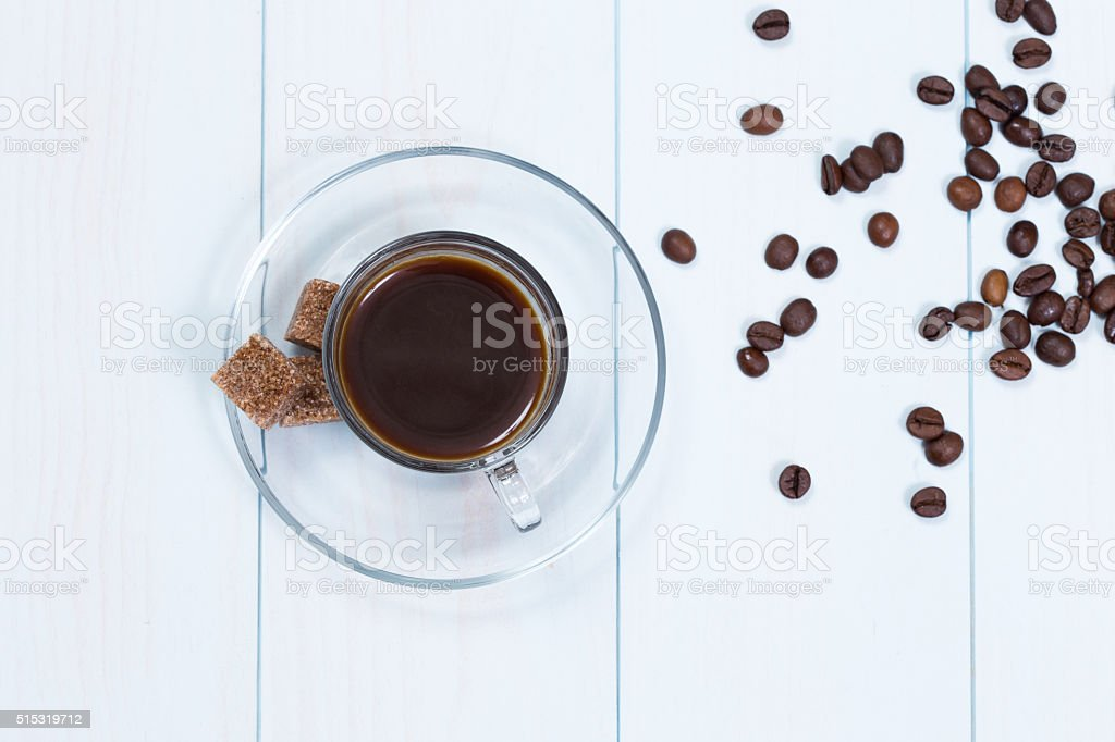 Espresso cup of coffee, sugar and beans stock photo