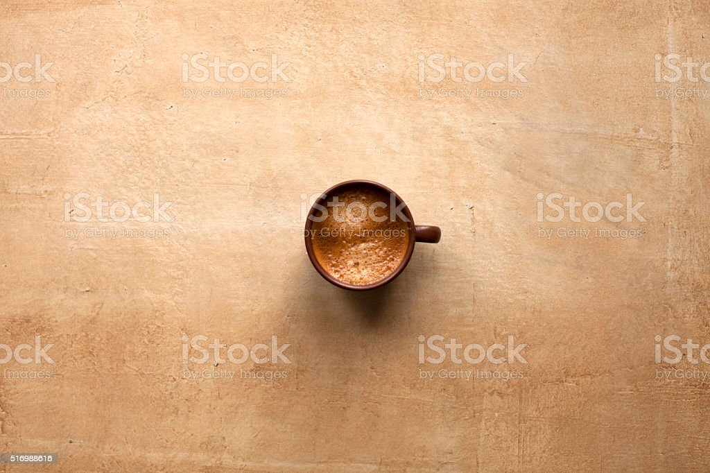 Espresso cup on brown stock photo