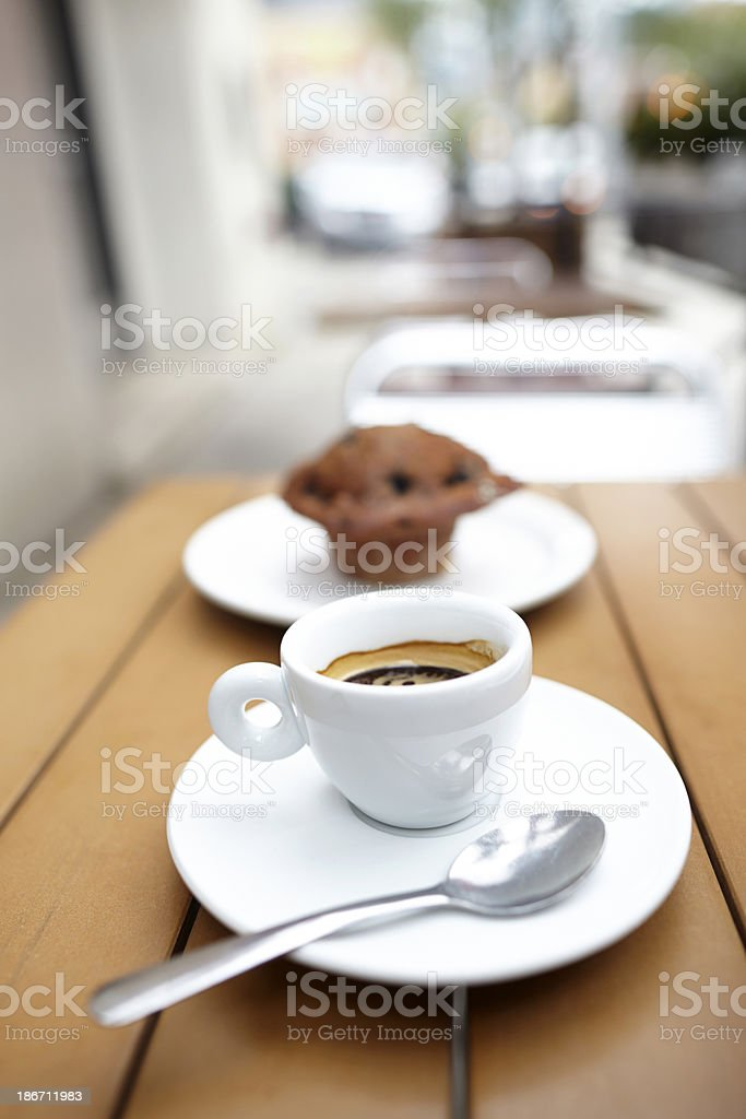 Espresso drink with muffin close-up royalty-free stock photo
