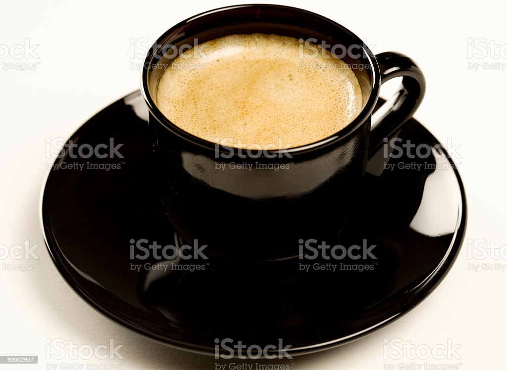 Espresso in a black cup royalty-free stock photo