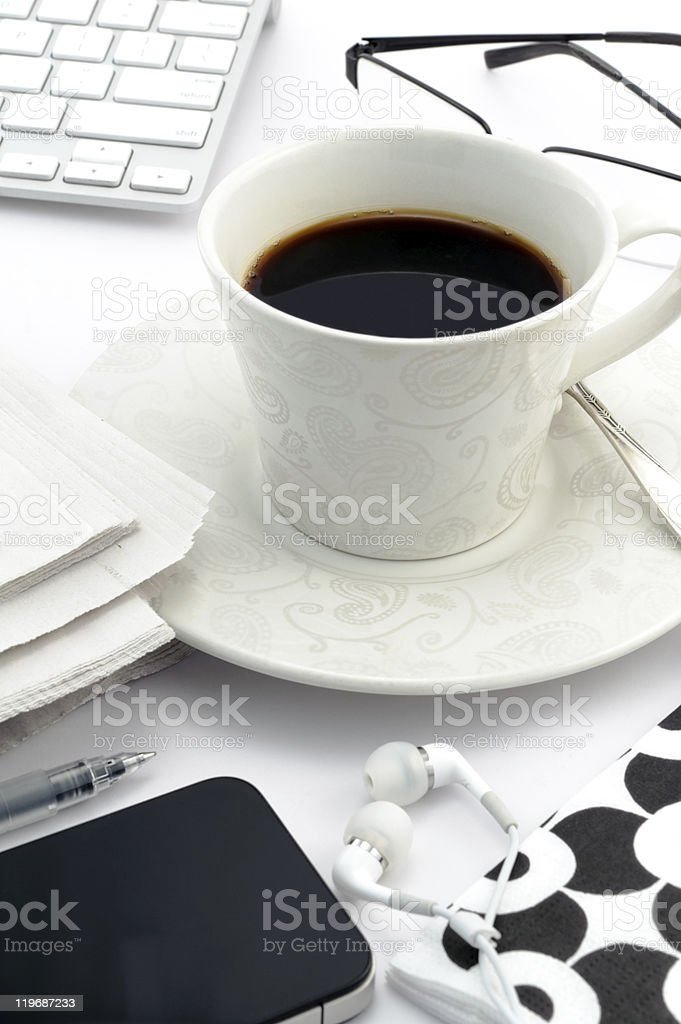 Espresso in vintage cup with mobile telephone royalty-free stock photo
