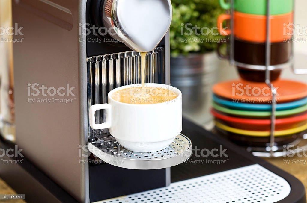 Espresso machine and a coffee cup stock photo