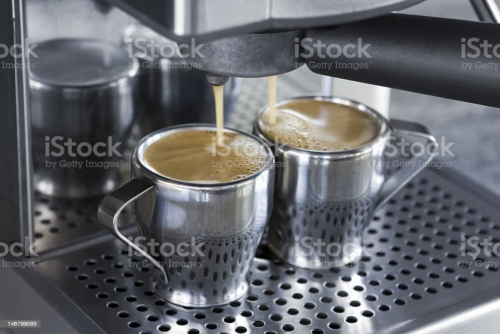 espresso machine dispensing coffee royalty-free stock photo
