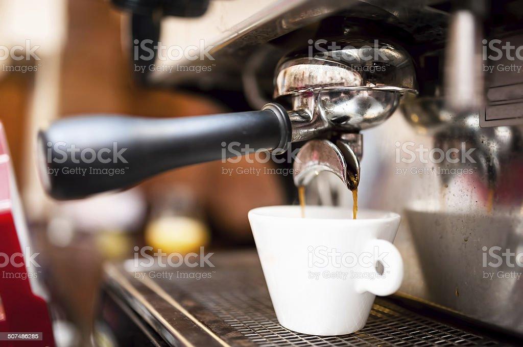 Espresso machine making coffee at restaurant stock photo