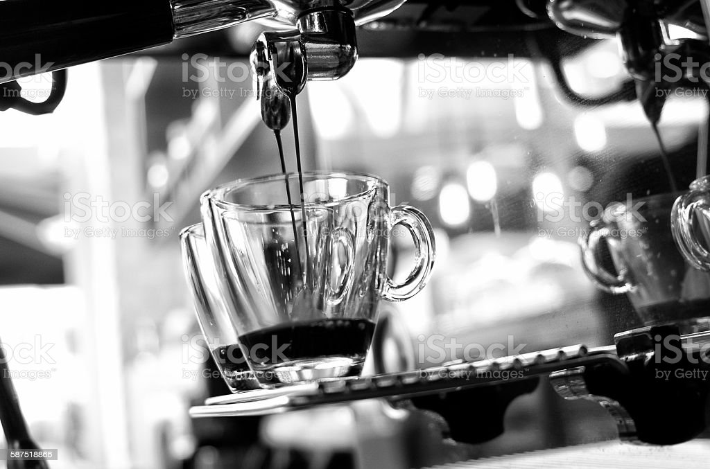 espresso pouring from coffee machine. stock photo