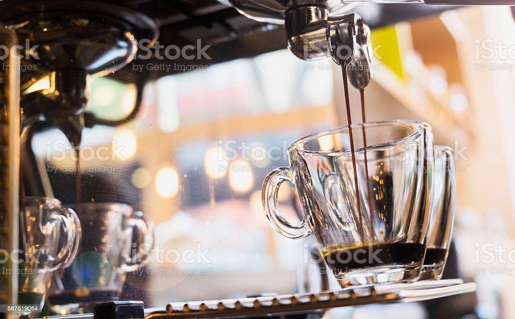 espresso pouring from coffee machine. stock photo
