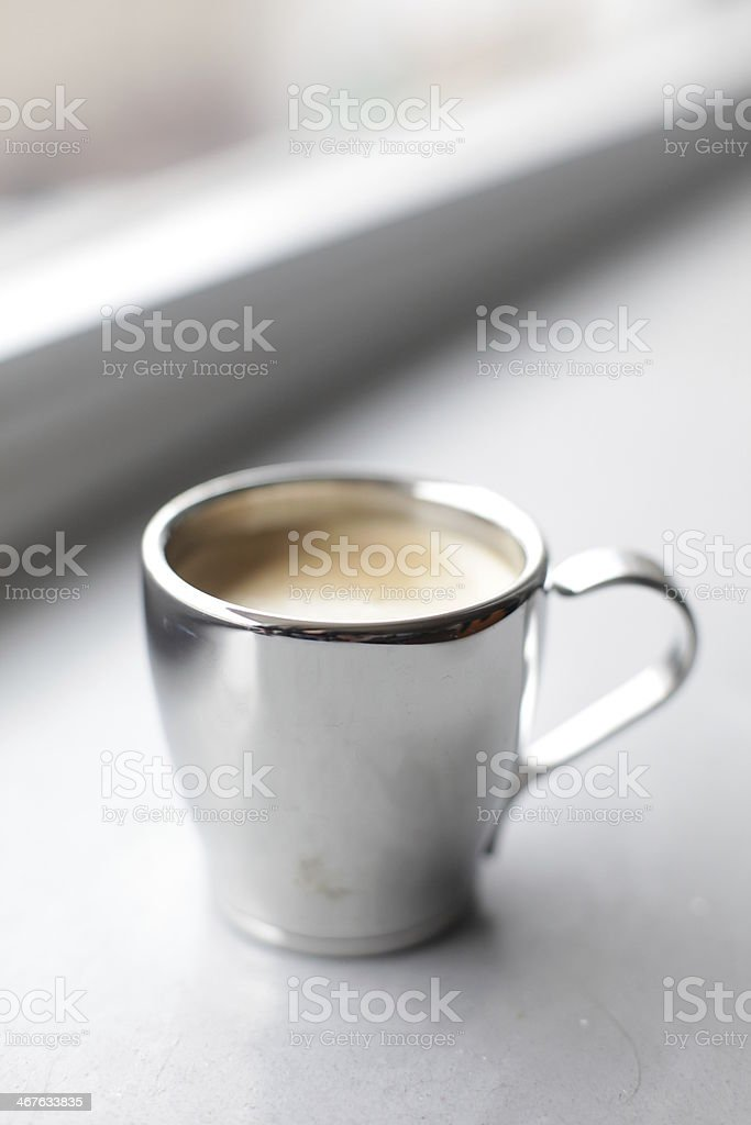 Espresso pouring into a cup royalty-free stock photo