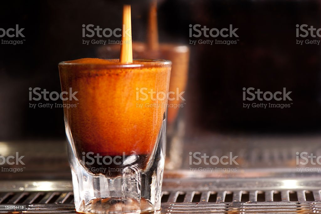 Espresso pouring into a shot glass on the coffee machine. royalty-free stock photo