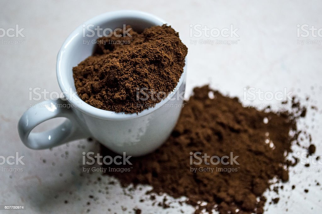 Espresso/Coffee Cup with Ground Coffee Powder Close Up royalty-free stock photo