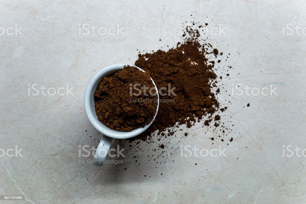 Espresso/Coffee Cup with Ground Coffee Powder Overhead View royalty-free stock photo