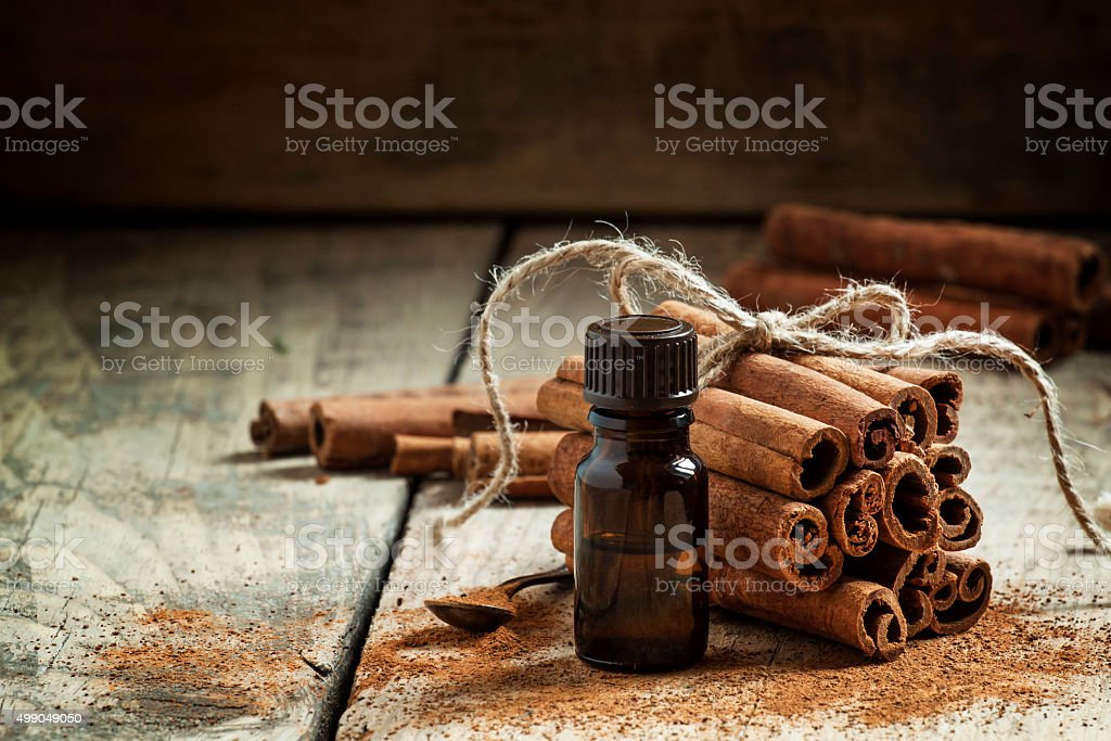 Essential cinnamon oil in a small bottle stock photo