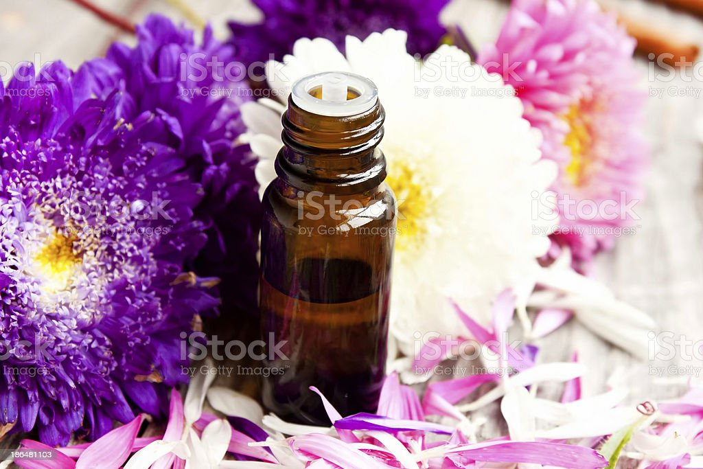 Essential oil and flowers royalty-free stock photo