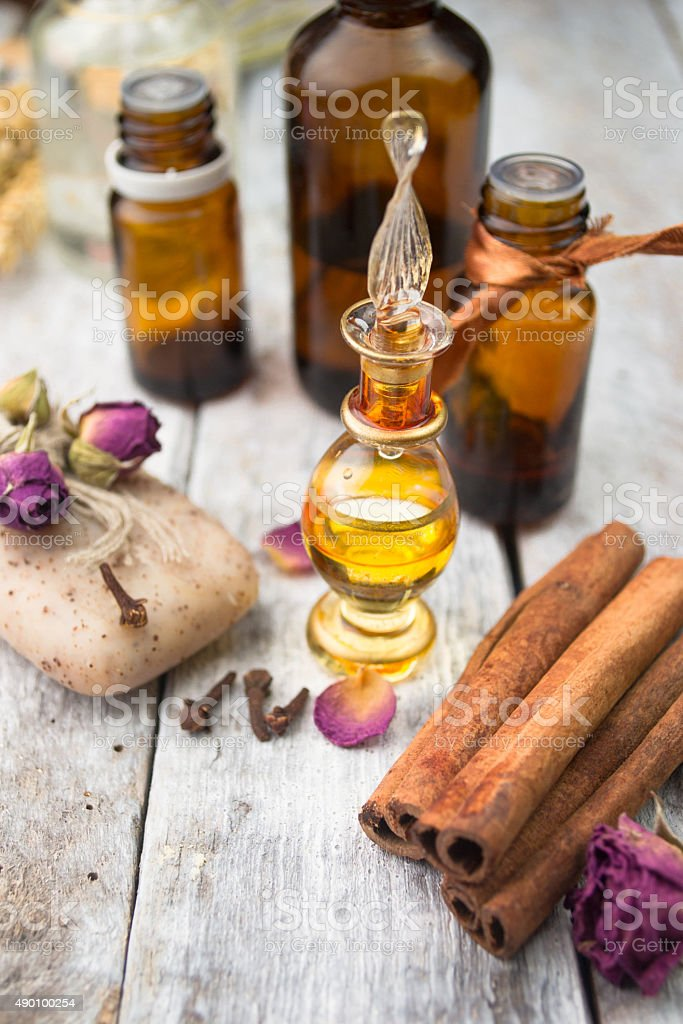 Essential oil and handmade soap on wooden background stock photo