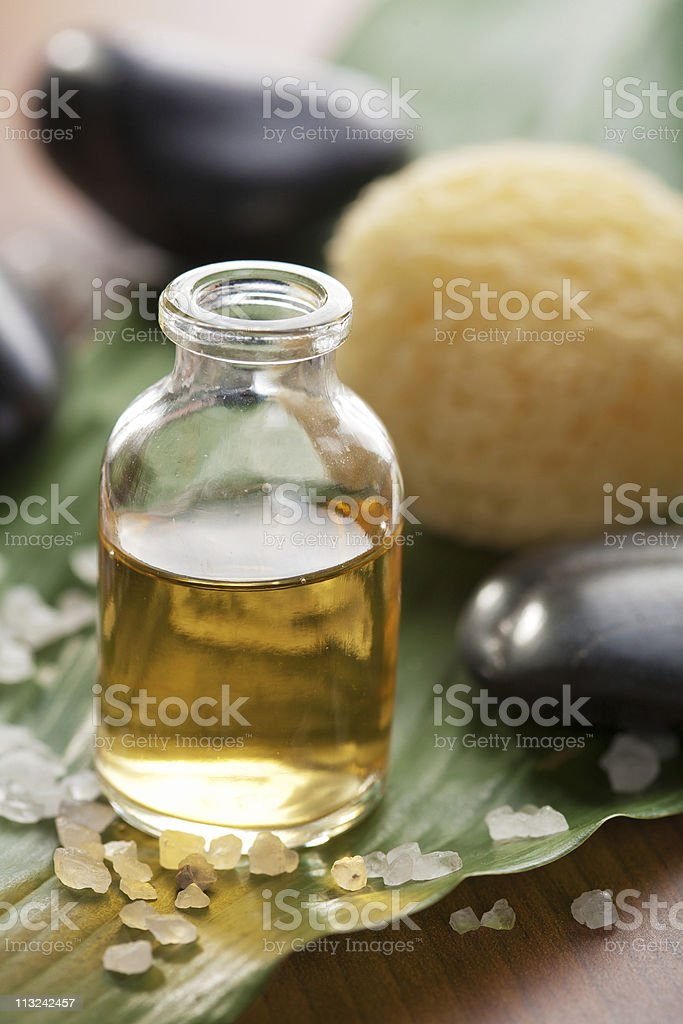 essential oil and stones stock photo