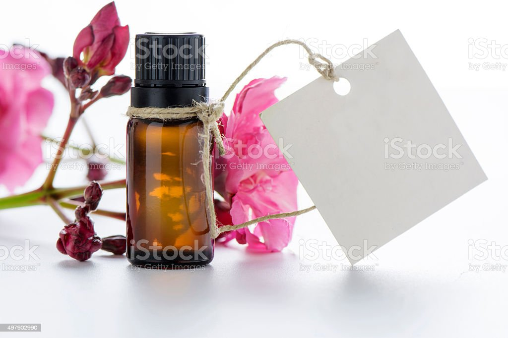 Essential oil, empty tags and roses flowers stock photo