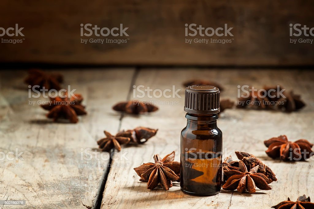 Essential oil of anise in a small brown bottle stock photo
