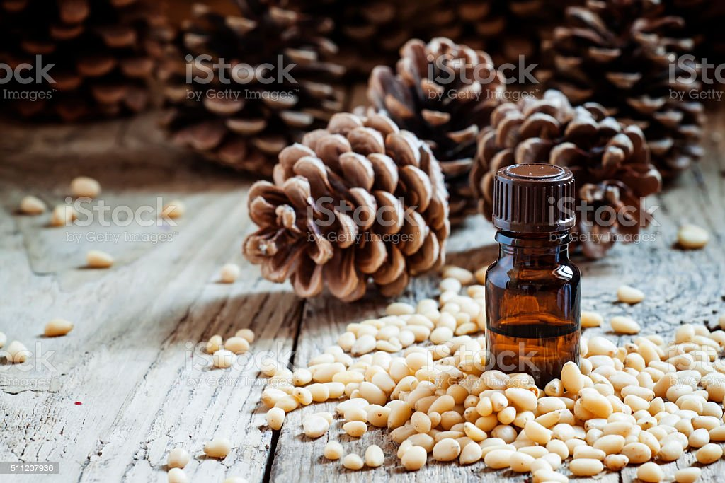 Essential oil of cedar in a small brown bottle stock photo