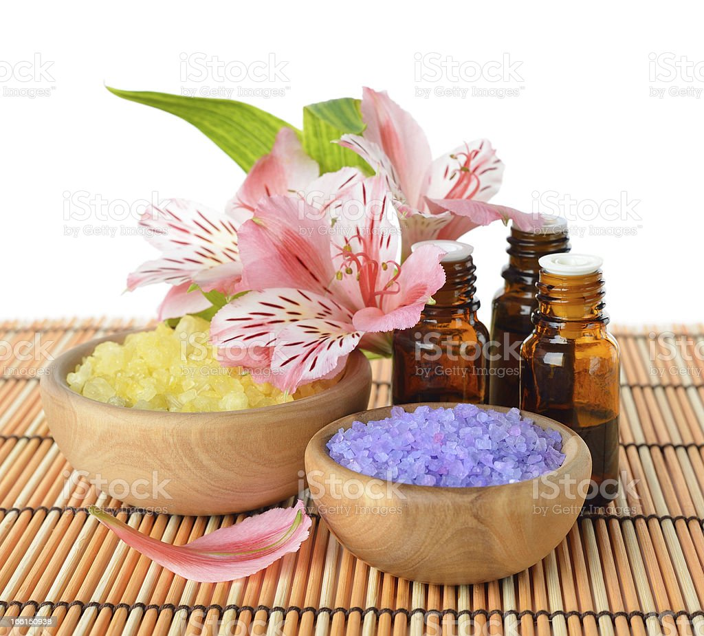 Essential oil, sea salt and flowers royalty-free stock photo