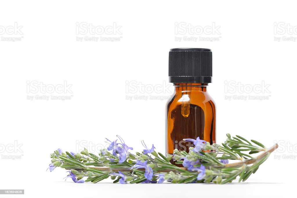 Essential Oil with Sprig of Fresh Rosemary royalty-free stock photo