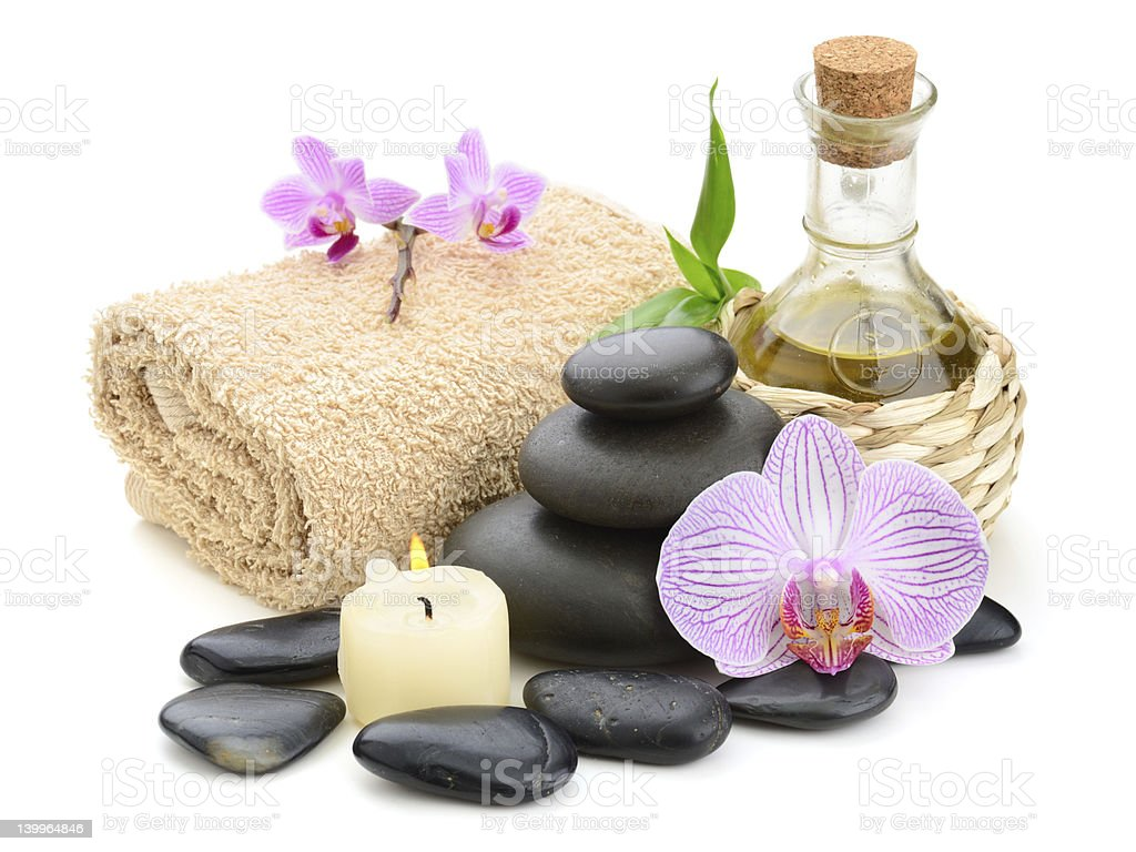 Essential oils a candle and other spa related items stock photo
