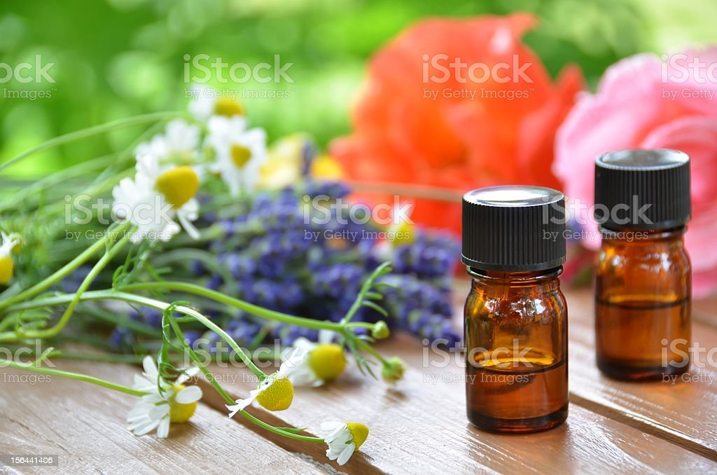 essential oils and herbal flowers for aromatherapy treatment stock photo