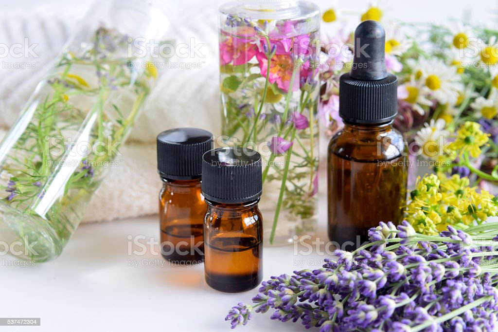 essential oils and natural cosmetics with herbs stock photo