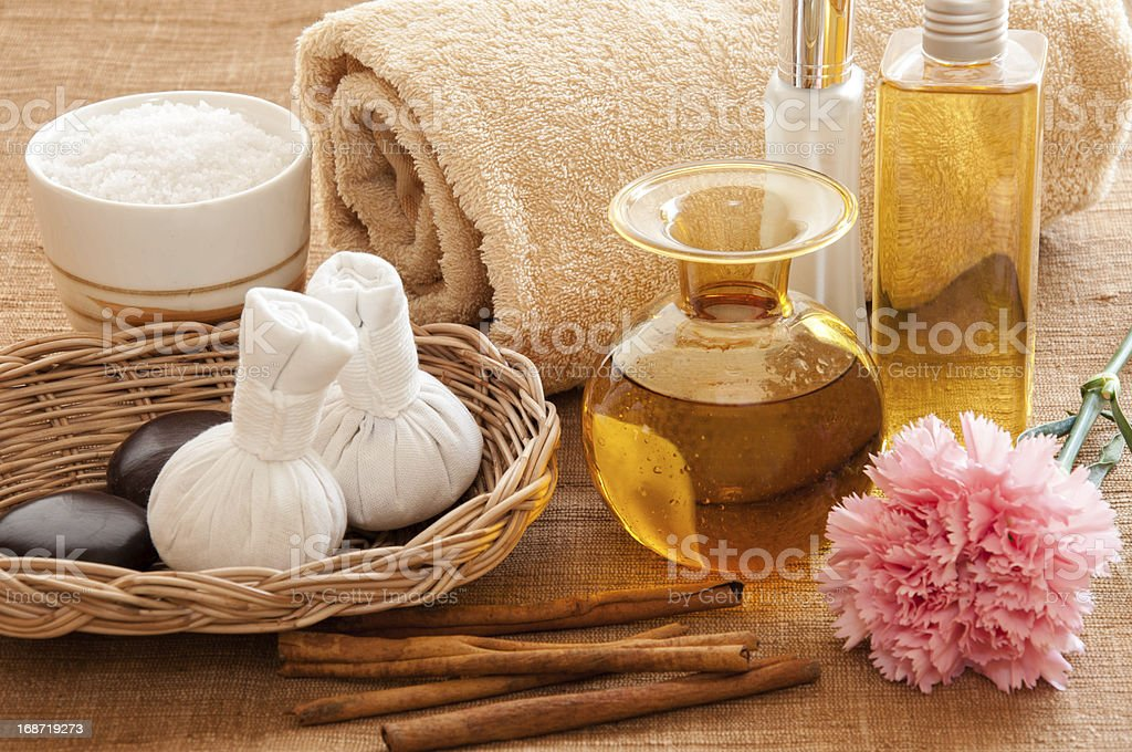 Essential oils and spices in a setting for spa relaxation stock photo