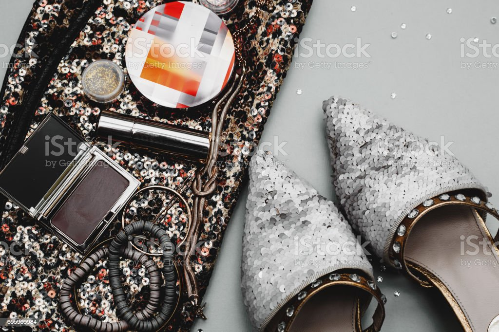 Essentials fashion woman objects on grey background stock photo