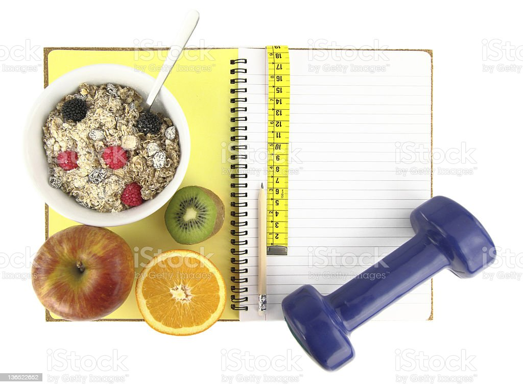 Essentials for a healthy lifestyle sitting atop a notebook stock photo