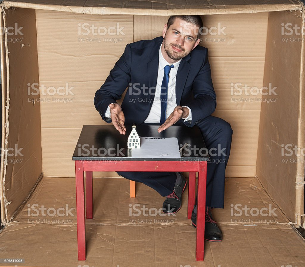 Estate agent presents a house to buy stock photo
