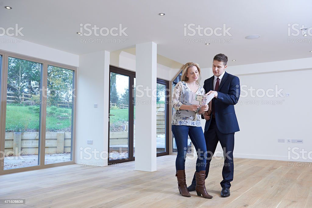 Estate agent showing a female buyer around the house stock photo