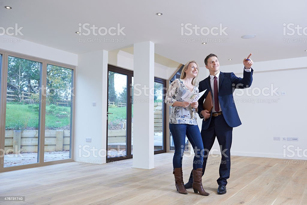 Estate Agent Showing Prospective Female Buyer Around Property stock photo