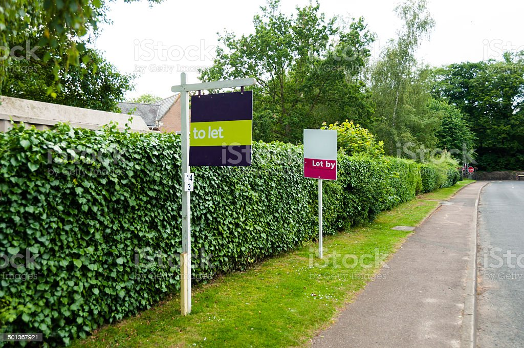 Estate agent sign to Let, and Let by stock photo