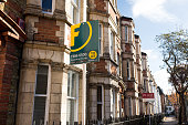 Estate agent signs outside Victorian terraced houses