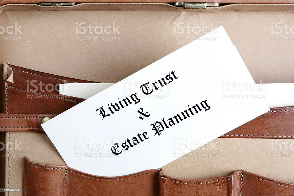 Estate planning documents in a leather briefcase stock photo