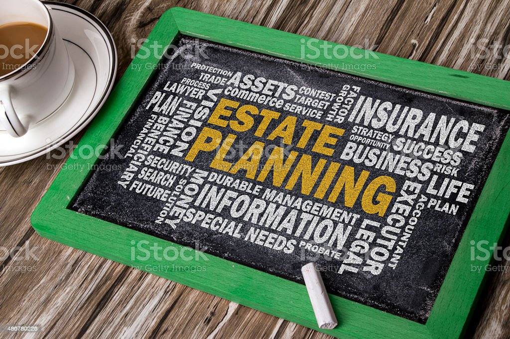 estate planning with related word cloud on blackboard stock photo