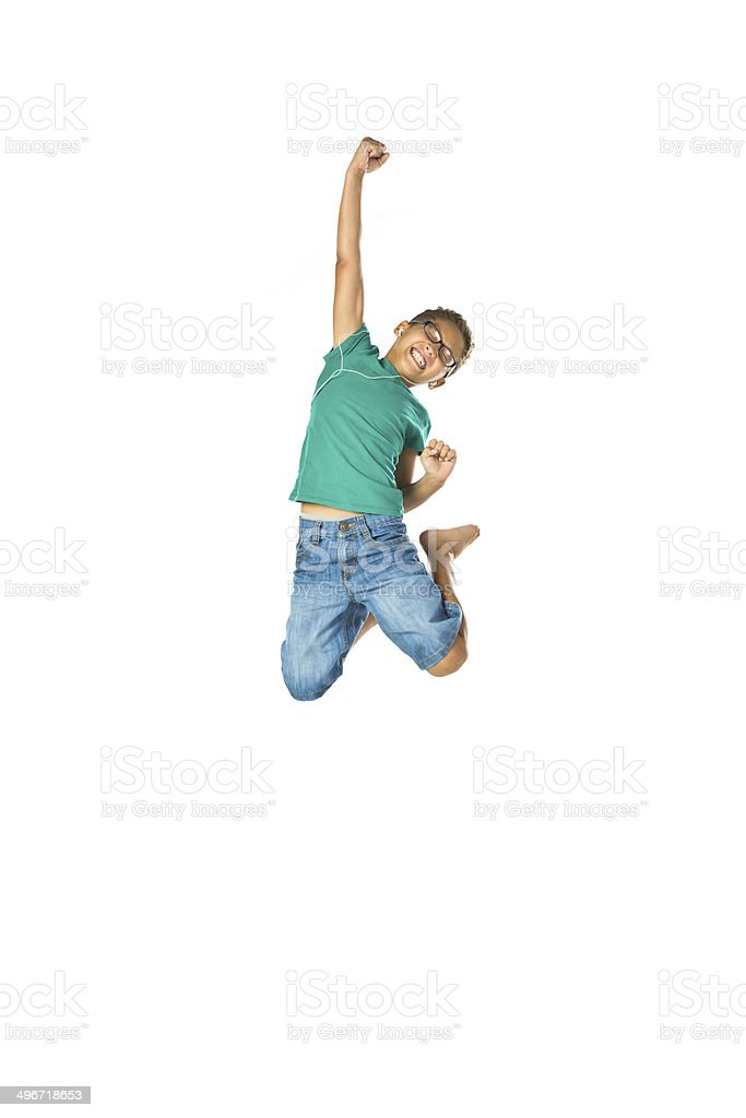 Estatic child jumping with fist in air stock photo