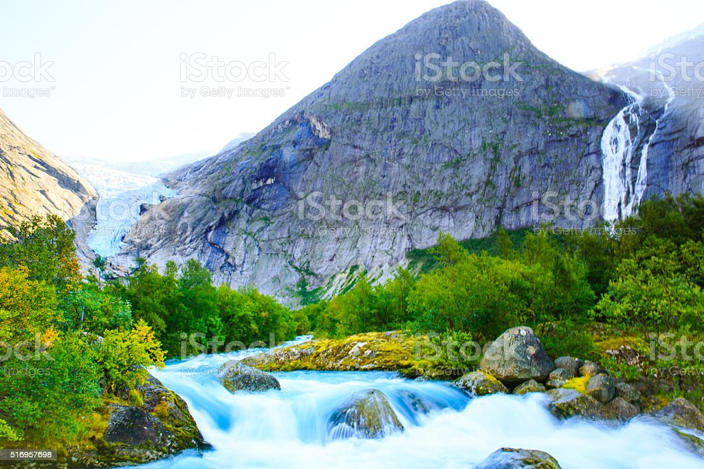 Eternal glaciers and waterfalls in the mountains . stock photo