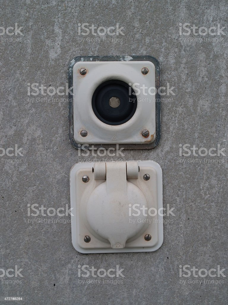 Eternit Wall with a switch and a outlet, Close up stock photo
