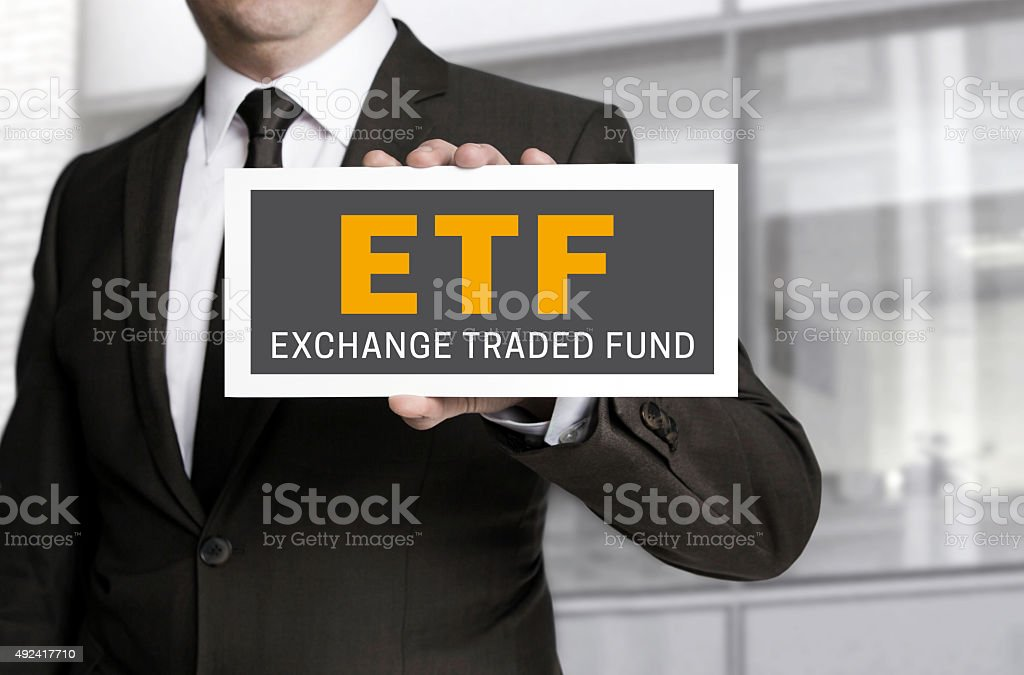 etf sign held by businessman background stock photo